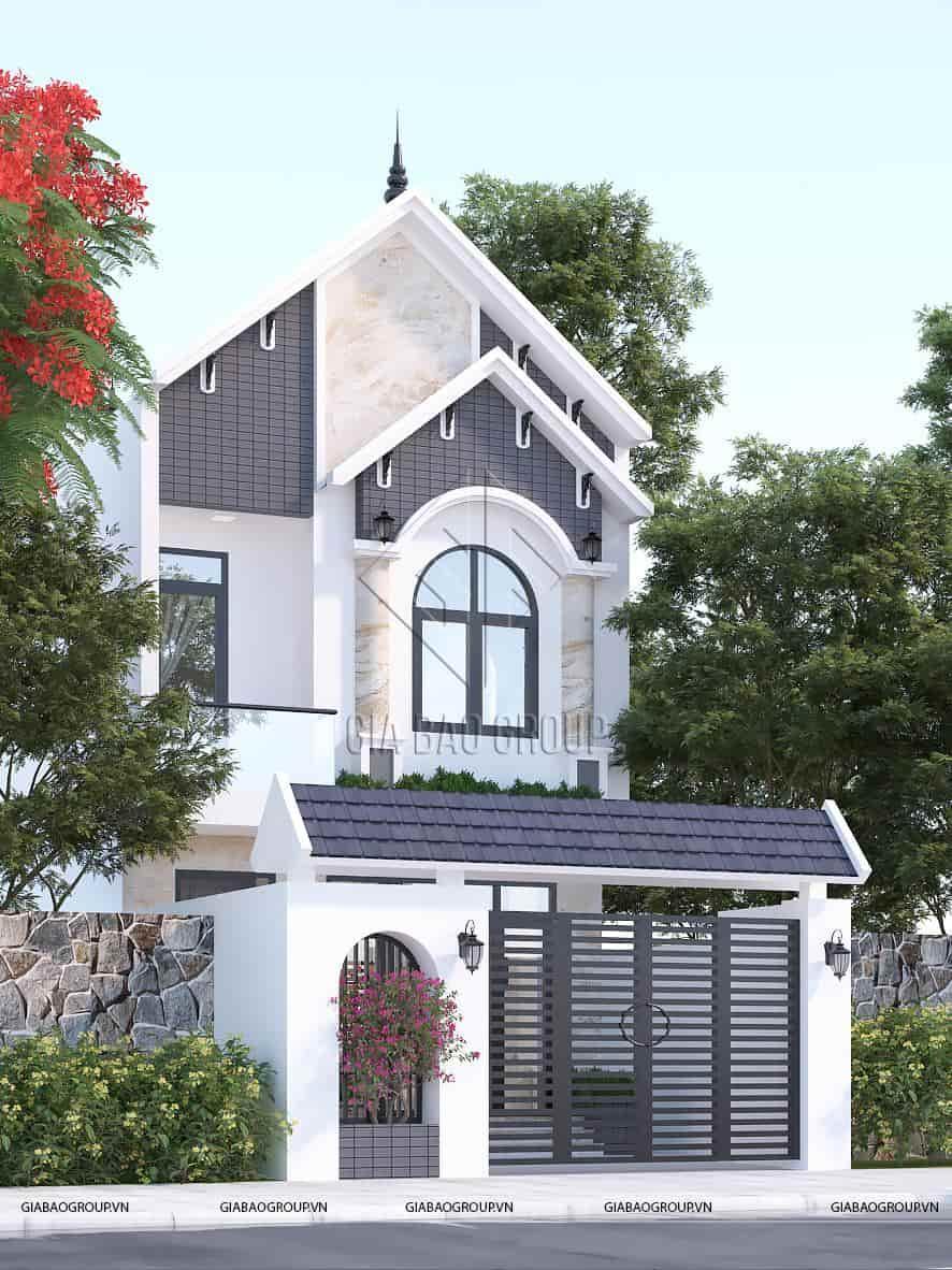 Thiết kế nhà phố mái thái tân cổ điển với ban công ngập tràn cây xanh