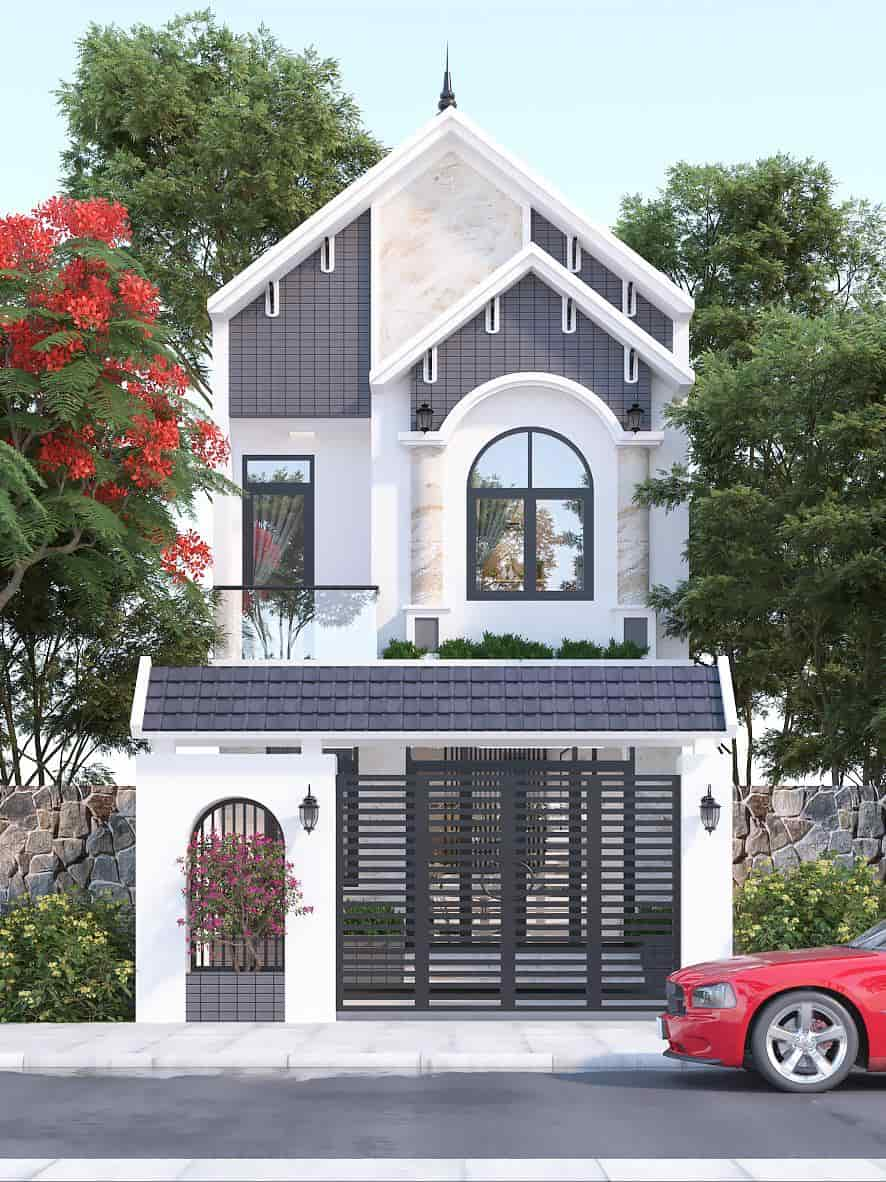 Cổng nhà bề thế tạo nên cảnh quan ấn tượng cho toàn căn nhà phố mái Thái