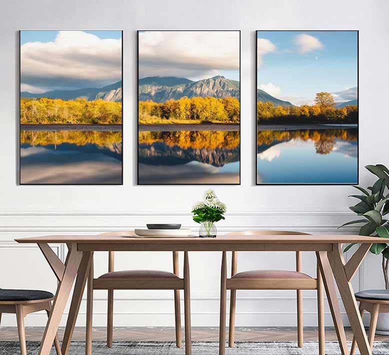 Ở phòng ăn, bạn có thể sử dụng tranh phong cảnh liên quan đến những địa điểm du lịch nổi tiếng mà gia đình thích cũng là một ý tưởng hay