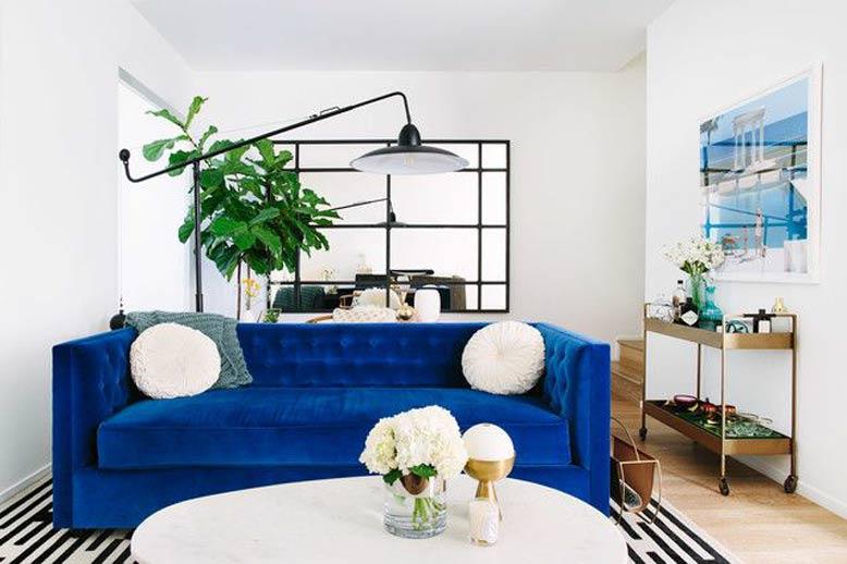 Phòng khách căn hộ chung cư ấn tượng với gam màu xanh nổi bật